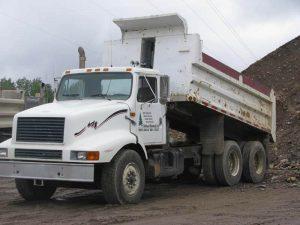 white truck dumping